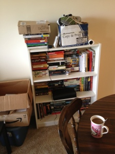 One of several bookshelves, arranged in the style of Tetris, or perhaps Jenga.